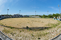 A wide-angle view from beyond the center field wall shows the neglected field at Kannapolis Intimidators Stadium on April 28, 2021 in Kannapolis, North Carolina. The Intimidators have changed their name to the Kannapolis Cannon Ballers and will play at the new Atrium Heath Ballpark in downtown Kannapolis, NC beginning with the 2021 season. (Brian Westerholt/Four Seam Images)