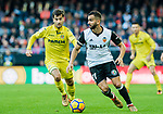 Martin Montoya Torralbo of Valencia CF (R) fights for the ball with Manuel Trigueros Munoz of Villarreal CF (L) during the La Liga 2017-18 match between Valencia CF and Villarreal CF at Estadio de Mestalla on 23 December 2017 in Valencia, Spain. Photo by Maria Jose Segovia Carmona / Power Sport Images