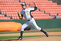 Dalton Saberhagen #31 of the Tennessee Volunteers delivers a pitch at Lindsey Nelson Stadium against the the Manhattan Jaspers on March 12, 2011 in Knoxville, Tennessee.  Tennessee won the first game of the double header 11-5.  Photo by Tony Farlow / Four Seam Images..