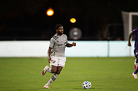 LAKE BUENA VISTA, FL - JULY 25: Orji Okwonkwo #18 of the Montreal Impact dribbles the ball during a game between Montreal Impact and Orlando City SC at ESPN Wide World of Sports on July 25, 2020 in Lake Buena Vista, Florida.
