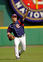 12 June 2006: Mike Stanton, pitcher for the Washington Nationals, warms up in the outfield prior to a game against the Colorado Rockies at RFK Stadium, in Washington, DC. The Nationals fell to the Rockies 4-3 in the first game of the four game series...Mandatory Photo Credit: Ed Wolfstein Photo..