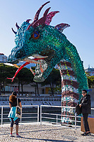 LISBON, PORTUGAL - MARCH 24: A person takes a picture of the plastic marine monster in Lisbon, on March 24, 2021. <br /> Lisboa now has a real Marine Monster which represents the increasing volume of plastic in the oceans. The installation was made with 12 tons of used disposable plastic bottles, placed at the Dock of Olivals, along with the Oceanario de Lisboa <br /> (Photo by Luis Boza/VIEWpress via Getty Images)