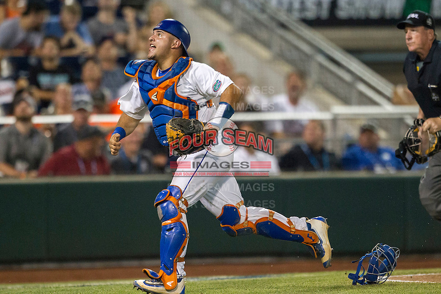 Florida Gators catcher Mike Rivera (4) tracks a foul ball against the Coastal Carolina Chanticleers in Game 4 of the NCAA College World Series on June 19, 2016 at TD Ameritrade Park in Omaha, Nebraska. Coastal Carolina defeated Florida 2-1. (Andrew Woolley/Four Seam Images)