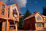 New home owners check the progress on their house under construction in Bellevue, Washington, Pacific Northwest, West Coast, USA