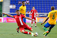 Harrison, NJ - Friday July 07, 2017: Lucas Cavallini, Cedric Fabien during a 2017 CONCACAF Gold Cup Group A match between the men's national teams of French Guiana (GUF) and Canada (CAN) at Red Bull Arena.