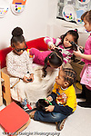 Education preschool 3-4 year olds group of children girls and boy in pretend play area involved in game