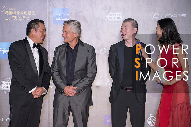 Michael Douglas and Feng Xiaygang at Red Carpet event at the World Celebrity Pro-Am 2016 Mission Hills China Golf Tournament on 20 October 2016, in Haikou, China. Photo by Marcio Machado / Power Sport Images
