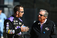 Feb 3, 2016; Chandler, AZ, USA; NHRA team owner Don Schumacher (right) talks with funny car driver Jack Beckman during pre season testing at Wild Horse Pass Motorsports Park. Mandatory Credit: Mark J. Rebilas-USA TODAY Sports