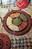Myanmar, Burma.  Burmese Appetizers:  Pickled Tea Leaves, Flat Beans, Peanuts, Fried Garlic, Sesame Seeds