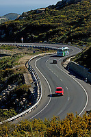 Cars and buses driving on e5 n340 highway near Tarifa, Andalusia, Spain.