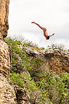 Red Bull Men and Women Cliff Divers do battle at the Hell's Gate Cliffs at Possum Kingdom Lake in Palo Pinto County, Texas.