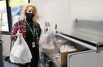WATERBURY CT. - 15 January 2020-011521SV01-Concepcion Ferrer hands out lunch bags to families at Driggs Elementary School in Waterbury Friday. The school gives out about 35 lunches a day.<br /> Steven Valenti Republican-American