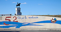 """Cuba, Havana.  """"Everything for the Revolution"""" Billboard.  Monument to General Maximo Gomez in background."""