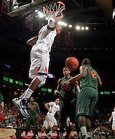 CHARLOTTESVILLE, VA- JANUARY 7: Darion Atkins #32 of the Virginia Cavaliers dunks the ball in front of Miami Hurricane defenders during the game on January 7, 2012 at the John Paul Jones Arena in Charlottesville, Virginia. Virginia defeated Miami 52-51. (Photo by Andrew Shurtleff/Getty Images) *** Local Caption *** Darion Atkins