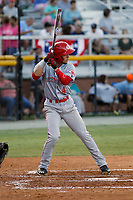 Greeneville Reds shortstop Claudio Finol (4) at bat during a game against the Burlington Royals at the Burlington Athletic Complex on July 7, 2018 in Burlington, North Carolina.  Burlington defeated Greeneville 2-1. (Robert Gurganus/Four Seam Images)