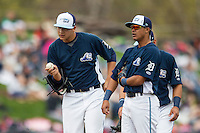 West Michigan Whitecaps pitcher Eudis Idrogo (26) and shortstop David Gonzalez (10) wait for a coach to arrive on the mound against the Dayton Dragons on April 24, 2016 at Fifth Third Ballpark in Comstock, Michigan. Dayton defeated West Michigan 4-3. (Andrew Woolley/Four Seam Images)