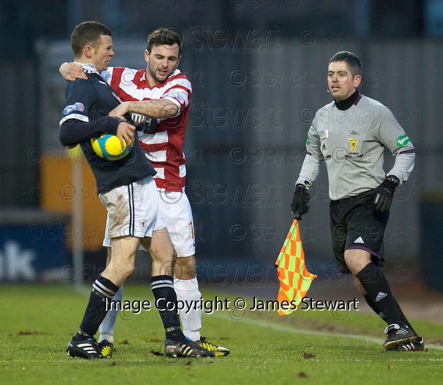 Raith's Eddie Malone and Accies Gary Fraser tussle for the ball.