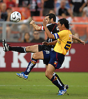 DC United midfielder Ben Olsen (14) tries to make a pass while covered by Monarcas Morelia defender Gustavo Trujillo (27). Monarcas Morelia tied DC United 1-1 in  the SuperLiga opening match of the group B, at RFK Stadium Washington DC, Wednesday July 26, 2007.