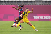 KASHIMA, JAPAN - AUGUST 5: Hayley Raso #16 of Australia challenges Crystal Dunn #2 of the United States for the ball during a game between Australia and USWNT at Kashima Soccer Stadium on August 5, 2021 in Kashima, Japan.