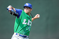 Starting pitcher Cody Reed (9) of the Lexington Legends warms up for his Class A debut against the Greenville Drive on Sunday, April 27, 2014, at Fluor Field at the West End in Greenville, South Carolina. Reed was a second-round pick of the Kansas City Royals in the 2013 First-Year Player Draft. Greenville won, 21-6, and Reed took the loss. (Tom Priddy/Four Seam Images)