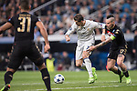 Cristiano Ronaldo of Real Madrid fights for the ball with Marek Hamsik of SSC Napoli during the match Real Madrid vs Napoli, part of the 2016-17 UEFA Champions League Round of 16 at the Santiago Bernabeu Stadium on 15 February 2017 in Madrid, Spain. Photo by Diego Gonzalez Souto / Power Sport Images