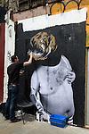 Street artist making street art Brick Lane London E1