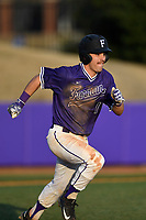 Second baseman Sims Griffith (1) of the Furman Paladins runs out a batted ball in game two of a doubleheader against the Harvard Crimson on Friday, March 16, 2018, at Latham Baseball Stadium on the Furman University campus in Greenville, South Carolina. Furman won, 7-6. (Tom Priddy/Four Seam Images)
