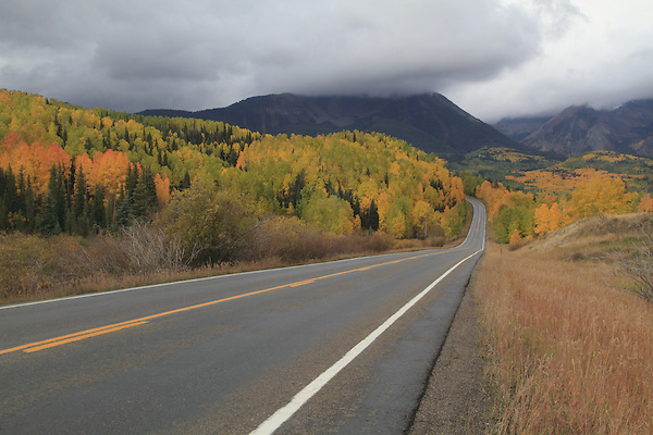 Paved road in the San Juan Mountains, autumn, Colorado.