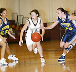WATERBURY, CT,  02 JANUARY 2006, 010207BZ09- Sacred Heart's Kelsey Dunn (14) drives through Kennedy's Jaleesa Roy (25) and Amber Alberto (23) during their game at Sacred Heart High School in Waterbury Tuesday.<br /> Jamison C. Bazinet Republican-American