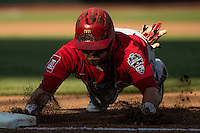 Cody Ramer #13 of the Arizona Wildcats slides during a College World Series Finals game between the Coastal Carolina Chanticleers and Arizona Wildcats at TD Ameritrade Park on June 27, 2016 in Omaha, Nebraska. (Brace Hemmelgarn/Four Seam Images)