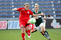 Washington Freedom defender Cat Whitehill (4) clears the ball in front of Chicago Red Star forward Ella Masar (3).  The Washington Freedom defeated the Chicago Red Stars 3-2 at Toyota Park in Bridgeview, IL on July 26, 2009.