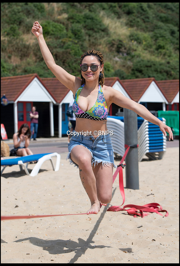 BNPS.co.uk (01202 558833)<br /> Pic: PhilYeomans/BNPS<br /> <br /> On Balance - the weather is superb on Bournemouth beach this sparkling weekend.