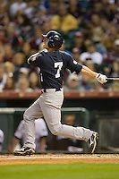 Brock Holt #7 of the Rice Owls follows through on his swing versus the Texas A&M Aggies in the 2009 Houston College Classic at Minute Maid Park February 28, 2009 in Houston, TX.  The Owls defeated the Aggies 2-0. (Photo by Brian Westerholt / Four Seam Images)