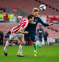 20th March 2021; Bet365 Stadium, Stoke, Staffordshire, England; English Football League Championship Football, Stoke City versus Derby County; James Chester of Stoke City and Kamil Jozwiak of Derby County challenges for the ball in front of James Chester of Stoke City