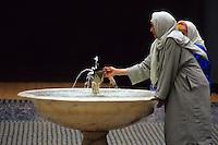 Fez, Morocco - Woman at Fountain, Zawiya of Moulay Idris II, Old Fez.