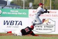 Mahoning Valley Scrappers Tony Wolters #1 turns a double play as Garrett Wittels slides in during the first game of a doubleheader against the Batavia Muckdogs at Dwyer Stadium on August 22, 2011 in Batavia, New York.  Batavia defeated Mahoning Valley 3-2.  (Mike Janes/Four Seam Images)