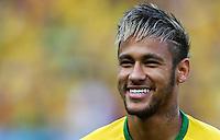 Neymar of Brazil smiles before kick off