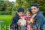 Imran, Alisha and Kamran Muhammad, Clash, Tralee, pictured with their pet chicken on Monday evening last.