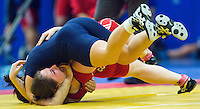11 MAY 2014 - SHEFFIELD, GBR - Olga Butkevych (top) attempts to pin Sarah Connolly during their women's 55kg category freestyle match at the British 2014 Senior Wrestling Championships in EIS in Sheffield, Great Britain  (PHOTO COPYRIGHT © 2014 NIGEL FARROW, ALL RIGHTS RESERVED)