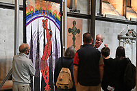 BNPS.co.uk (01202) 558833<br /> Pic: ZacharyCulpin/BNPS<br /> <br /> 8 million stitches, 1 Holy Exhibition<br /> <br /> Pictured: Visitors with the embroidery entitled, 'Danger – a snake in the Garden'<br /> <br /> Twelve large embroidered panels fashioned from eight million stitches which tell the story of 'the Creation' have gone on display at Salisbury Cathedral.<br /> <br /> The panels, which measure up to 8ft by 11ft, are made from silk, hand-dyed materials, gold leaf and metallic leathers.<br /> <br /> They have been created by Devon-based textile artist Jacqui Parkinson who has dedicated three years to the solo project.<br /> <br /> The panels are inspired by the poetic verses of Genesis, the first book in the Bible, and include depictions of the Garden of Eden.