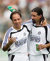2005 National Soccer Hall of Fame inductees Fernando Clavijo  and Marcelo Balboa suited up for the Colorado Rapids in the Hall of Fame Game that followed after the Hall of Fame induction ceremony. Balboa is pouring fluid over Clavijo's head during the half time break. At-A-Glance Field, Wright Soccer Campus, Oneonta, NY, on August  29, 2005.