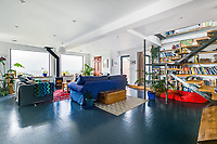 BNPS.co.uk (01202 558833)<br /> Pic: LillicrapChilcott/BNPS<br /> <br /> Pictured: The living room.<br /> <br /> Homebuyers can get the best of coast and country with this spectacular house on the market for offers in excess of £1.5m.<br /> <br /> Westfield sits in an incredible position with views over its own land and the sea at Trevaunance Cove in Cornwall.<br /> <br /> The four-bedroom family home is on the edge of the sought-after village of St Agnes, popular with locals, second home owners and holidaymakers.<br /> <br /> The hub of the home is the open-plan kitchen/family room with a folding door that opens up to the sea-facing terrace.