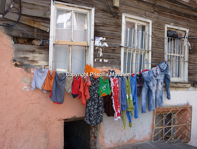 Istanbul, Turkey - September 23, 2009:  Colorful clothes hang from a clothesline outside a home.