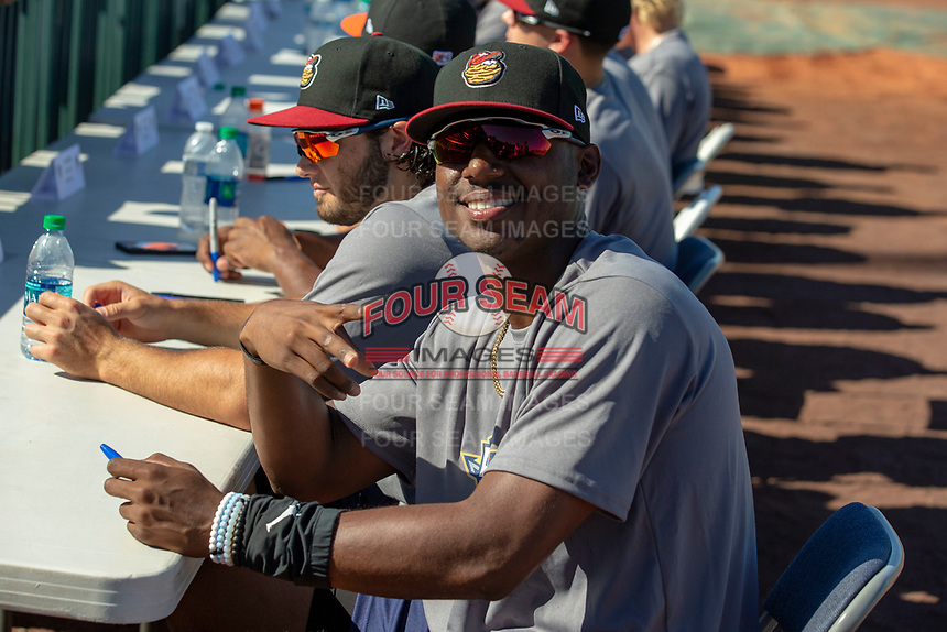 Kyle Lewis (1) of the Modesto Nuts signs autographs prior to the 2018 California League All-Star Game at The Hangar on June 19, 2018 in Lancaster, California. The North All-Stars defeated the South All-Stars 8-1.  (Donn Parris/Four Seam Images)