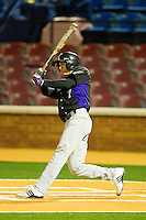 Patrick Miller #7 of the Northwestern Wildcats follows through on his swing against the Wake Forest Demon Deacons at Gene Hooks Field on February 26, 2011 in Winston-Salem, North Carolina.  Photo by Brian Westerholt / Four Seam Images