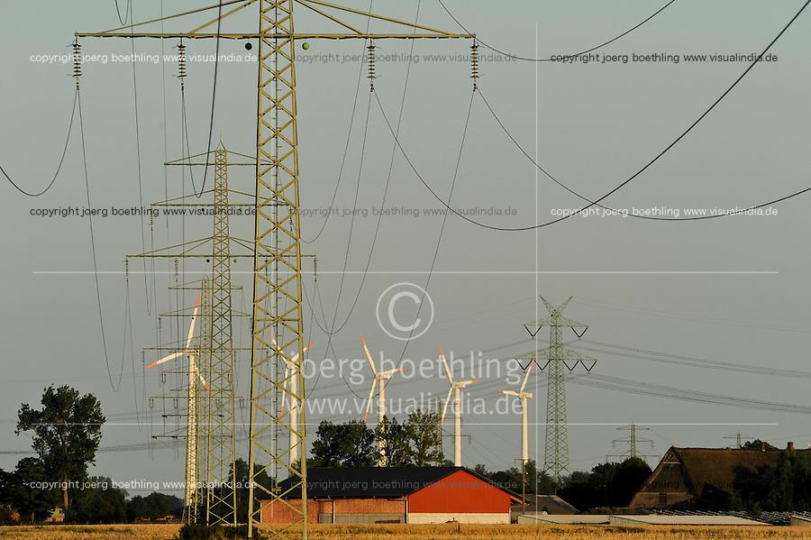 Deutschland Glueckstadt Stromleitungen und Windturbinen .   Europe Germany GER wind energy and grid