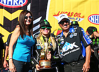 Aug 21, 2016; Brainerd, MN, USA; NHRA top fuel driver Brittany Force (center) celebrates with father John Force (right) and mother Laurie Force after winning the Lucas Oil Nationals at Brainerd International Raceway. Mandatory Credit: Mark J. Rebilas-USA TODAY Sports