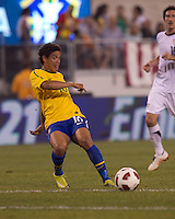 Brazil midfielder Carlos Eduardo (16) slips a pass through. Brazil  defeated the US men's national team, 2-0, in a friendly at Meadowlands Stadium on August 10, 2010.