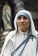 """Calcutta, India. April 04, 1975.<br /> Mother Teresa in front of a statue of the Virgin Mary at her Kalighat Home for the Dying in Calcutta. The first Home for the Dying opened in 1952 and was a free hospice for the poor. Mother Teresa (Agnes Gonxha Boyaxihu) the Roman Catholic, Albanian nun revered as India's """"Saint of the Slums,"""" was awarded the 1979 Nobel Peace Prize."""