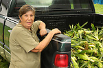 Woman with fresh corn in truck.  .Kathy's Vegetables